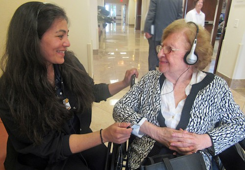 MorseLife CNA Olivia Emiko Thompson shares a musical moment with resident Thelma Kirsch